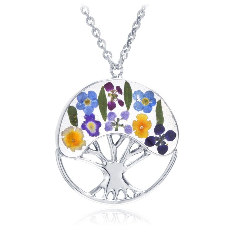 It is said that the tree of life is symbolic of the cycle of life representing birth, the passing of our loves, and eternity. Our tree of life necklace is sure to bring out this whimsical meaning through its circle of life shape and colorful everlasting flowers. The pendant features real pressed dried flowers including Forget Me Nots, Verbenas, Lantana Camaras and Pansies preserved in top-quality clear resin and encased in rhodium sterling silver. Grown in the fields of Taxco, Mexico, these…