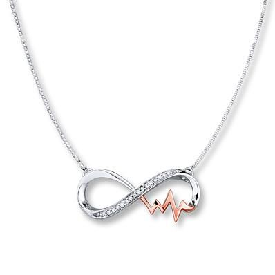 Sweet & so stunning, this endearing infinity necklace holds a beautiful heartbeat crafted in rose gold.