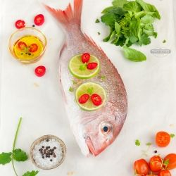 Baked New Zealand Red Snapper with fresh lime, chillies and herbs. Fresh and simple.