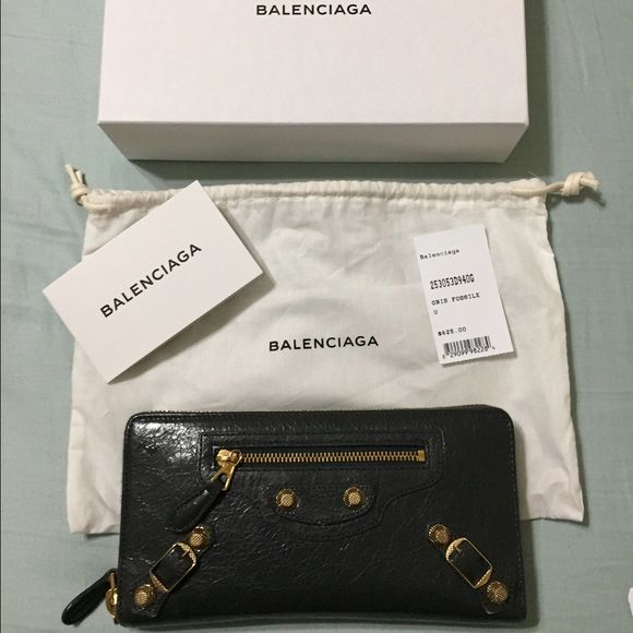 Balenciaga Wallet Gently used authentic Balenciaga zipper wallet. In good condition and has lots of card compartments and inner pocket with zipper for coins. Balenciaga Bags Wallets