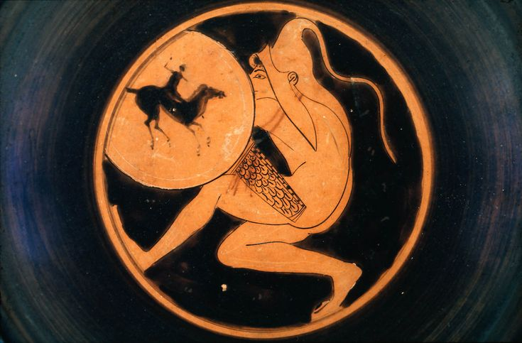 Drinking cup (kylix) with nude archer which crouches in ambush. He holds a shield with an elaborate shield device of a horse and rider. His quiver is tied around his shoulder and he wears a Scythian cap, distinctive to the non-Greek people who lived in the regions north and east of the black sea, who were famed archers. Provenance  By 1901: with Edward Perry Warren (according to Warren's records: Bought in Athens: from Locris.); purchased by MFA from Edward Perry Warren, December 1901