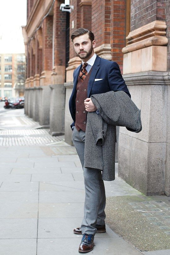 Terry Donovan - Wearing a TM Lewin jacket and shirt, River Island waistcoat, Piere Cardin tie, Reiss trousers, Oliver Sweeney shoes and carrying an HM overcoat.  London Collection: Mens Street Style