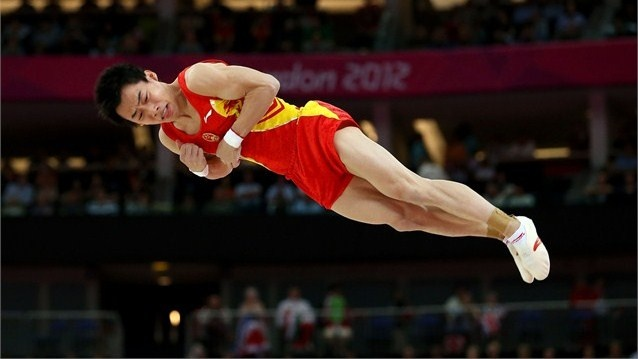 Zou Kai of China competes on the floor in the Artistic Gymnastics Men's Floor Exercise final on Day 9 of the London 2012 Olympic Games at North Greenwich Arena