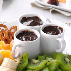 Chocolate Caramel Fondue Recipe -It's easy to keep the ingredients for this rich fondue on hand in case company drops by. I serve it in punch cups, so guests can carry it on a dessert plate alongside whatever fruit, pretzels and other dippers they like. —Cheryl Arnold, Lake Zurich, Illinois
