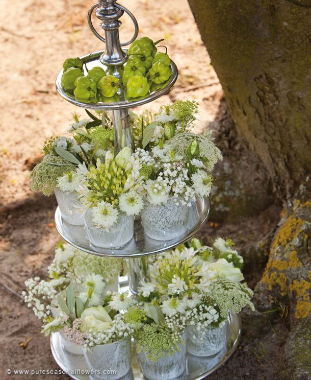 Fairy-tale - This etagère, put up in white shades, seems like light - The tulle-like flowers of Gypsophila combine beautifully with other white flowers, such as roses and field flowers.