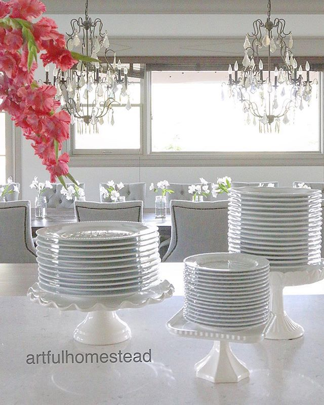Use cake stand to display plates during holiday dinners or for a party. Farmhouse, white dishes, classic