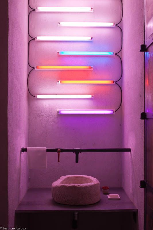 Neon lights in a bathroom create a vibrant pink glow  #designer #architect #interiordesign #colour #interiors #trends
