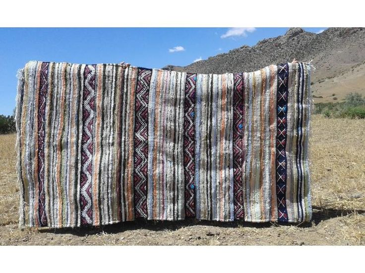 rag: Boucherouite Rug Uniquely handmade by artisans using Rag Fabric and Cotton. Crafted by Association Nahda from Souq El Hed, Morocco. Qty: 1