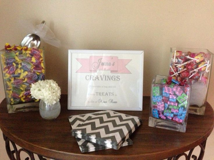 """Baby shower favor - the mom-to-be's cravings.  Jenna craved Jolly Ranchers so we had Jolly Ranchers, Jolly Rancher lollipops, Jolly Rancher Chews. Sign - """"Jenna's Cravings. Please take a bag and fill it with something sweet in honor of Anna Reese"""""""