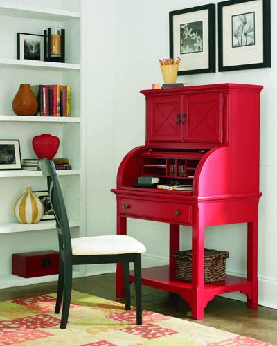 A vibrant piece for a small space, the Barrel roll top desk from Riverside offers many conveniences along with a charge of color. It features an open area for electronic and accessory storage, storage space behind the roll top, a pull-out work surface, storage drawer and lower shelf... Shown here in chili pepper red.