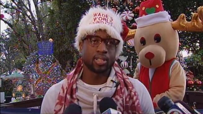 donning red and white santa hat miami heat guard nba all star heidi ufer shane battier wife bio wiki photos