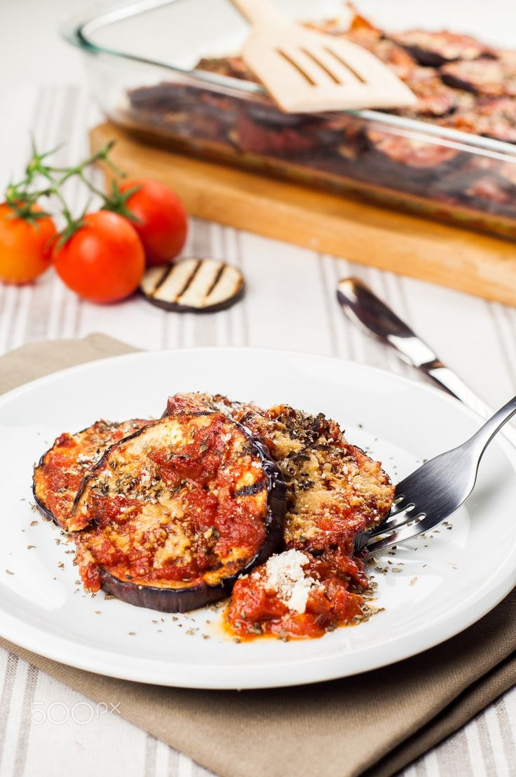 Delicious parmigiana on white plate - Delicious parmigiana on white plate on table