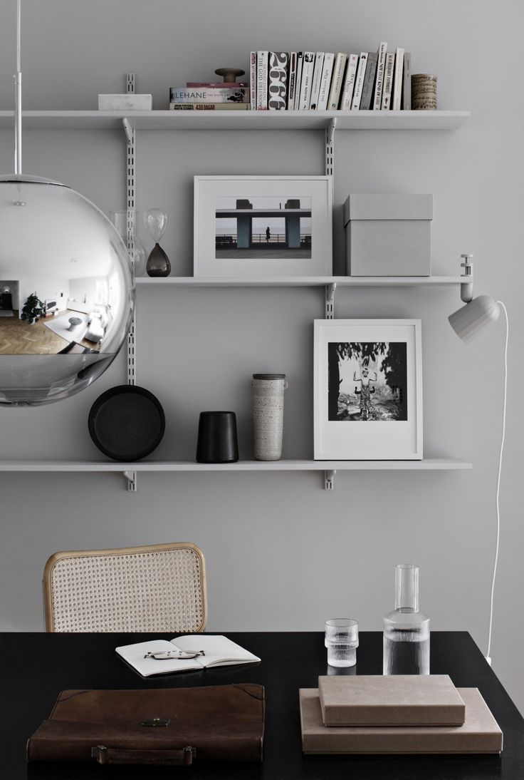 Home Office Organization | Silver globe light in home office.