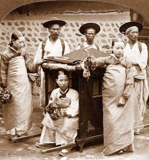 Korean Women and their Coach Bearers Photo by UNKNOWN Photographer, ca.1899-1900.