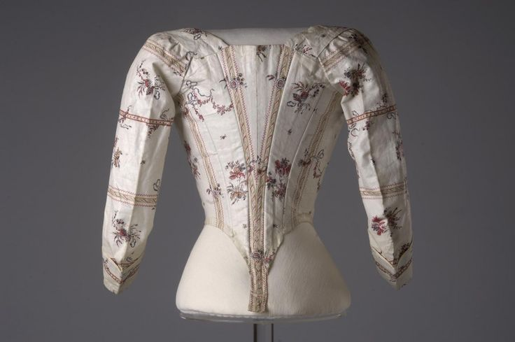 Rear view, bodice, 1780-1790. White glazed linen, block printed with stripes, medaillons and floral sprays in red, yellow, blue, mauve and brown, linen lining.