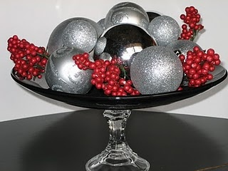Dollar store black plate, crystal candleholder, silver ornaments (3 sizes) and berries = centerpiece