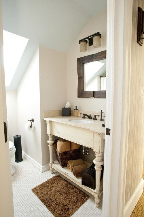 I love the idea of repurposing an old piece of furniture into a bathroom vanity.
