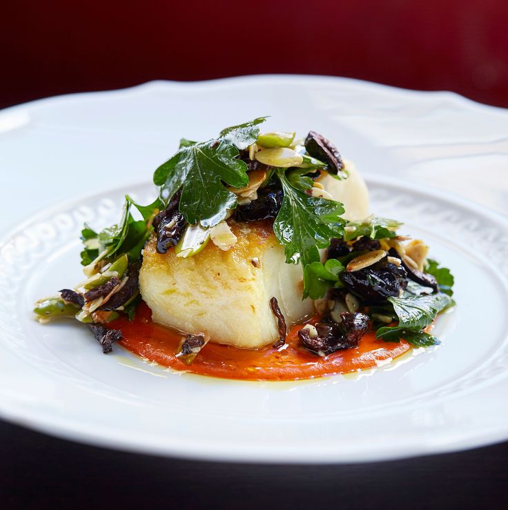 Roast cod and romesco sauce with olive and almond dressing for Italian fish sauce