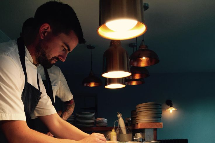Chef Robert Thompson at the stove after opening his first solo restaurant.
