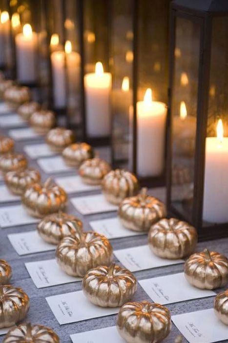 For an autumn wedding miniature ghost pumpkins can become downright glamorous with a touch of gold spray paint.: