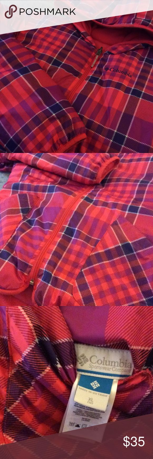 Columbia Reversable Puffer Jacket Super warm reversible Columbia puffer jacket.  One side has a warm fleece in pink and other side is a nylon plaid. Both sides have pockets too.  Girls XL (18).  Will fit a women's XS too. Has minimal wear and the edge of the sleeves show slight wear.  Priced accordingly to condition. Columbia Jackets & Coats Puffers