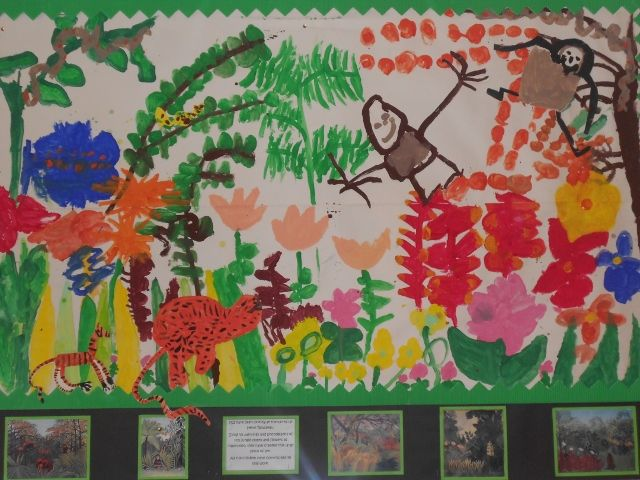 Children's collaborative art work based on 'Rousseau's' - Jungle Paintings. They children painted the plants and flowers using his work as inspiration. They painted the animals separately and they were added to work at the end.