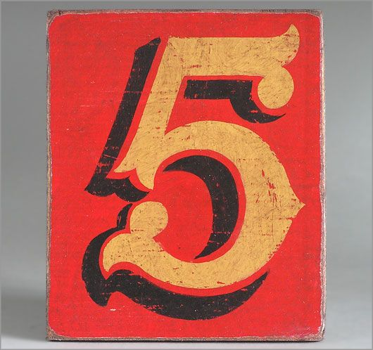 Hand-painted wooden sign: fairground number '5'