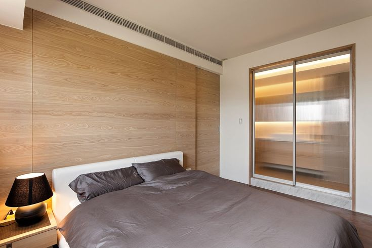 This stylish yet homey apartment design comes to us courtesy of Taiwan based Fertility Design, filling us with ideas on how to make a modest sized space appear