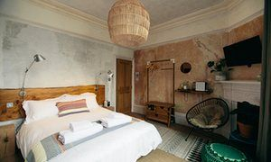 One of the Culpeper's five bedrooms, with distressed walls and a Scandi-design aesthetic