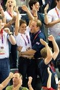 AUGUST 2 2012 - The royal couple made a rare public display of affection as they celebrated Team GB winning the gold medal in the London 2012 Olympics men's cycling team sprint.
