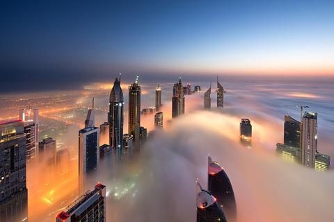 "Chilly morning in DIFC', by  DANIEL CHEONG  ""Dubai city lights make the most beautiful colored fog shot, and this one in particular shows great movement of the fog along with a great alignment of the Sheikh Zayed road buildings towards the morning light. It is one of my favorite pictures, because it conveys the very essence of the early morning experience to the viewer."""