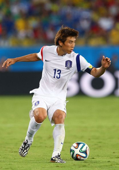 Koo Ja Cheol Photos - Koo Ja-Cheol  controls the ball during the 2014 FIFA World Cup Brazil Group H match between Russia and South Korea at Arena Pantanal on June 17, 2014 in Cuiaba, Brazil. - Koo Ja Cheol Photos - 92 of 132