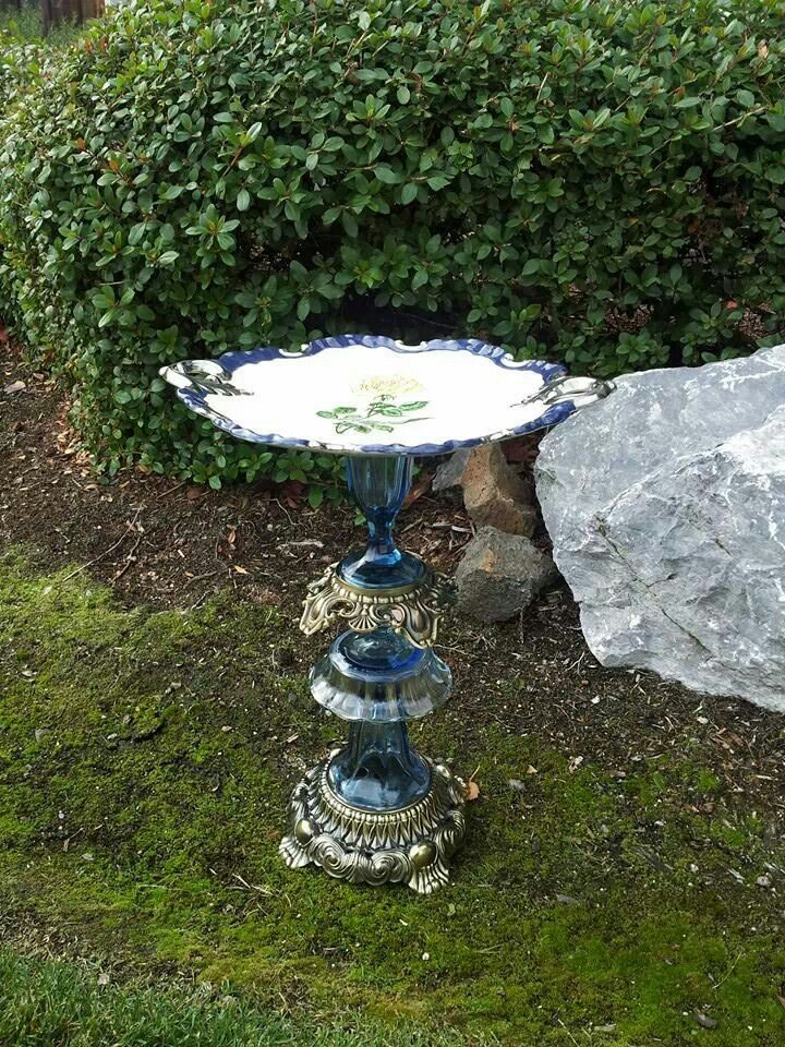 Vintage glass bird bath made with dishes and lamp parts.