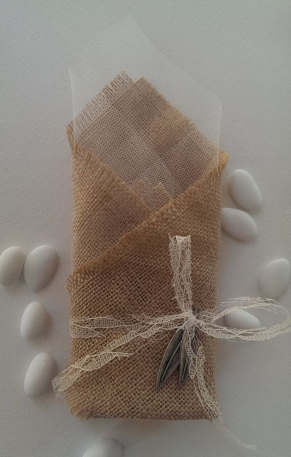 Handmade burlap wedding favor/bomboniere decorated with olive leaves in antique silver color.