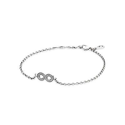 The dainty Infinity sterling silver bracelet with cubic zirconia is perfect for your wedding day to symbolize your endless love. #PANDORA #PANDORAbracelet
