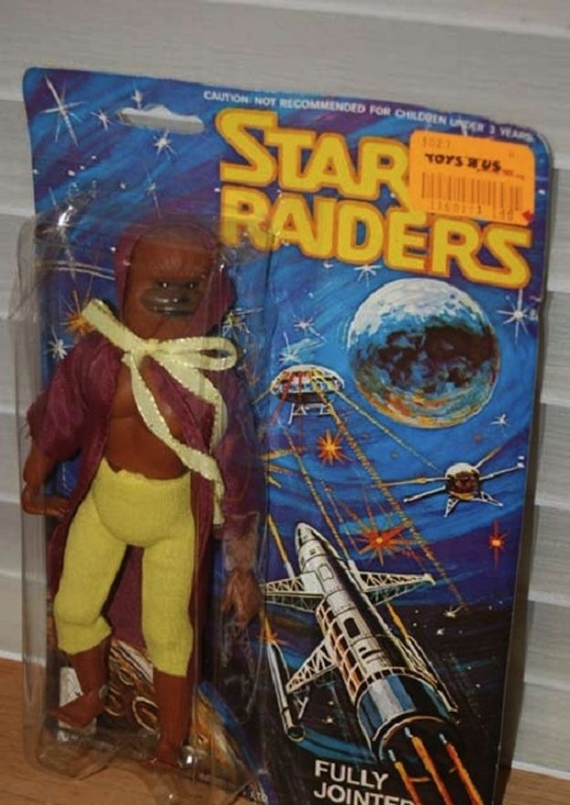"From a list called ""21 Terrible Action Figure Knock Offs"": Star Raiders! - Chewbacca knock off wearing a yellow ribbon"