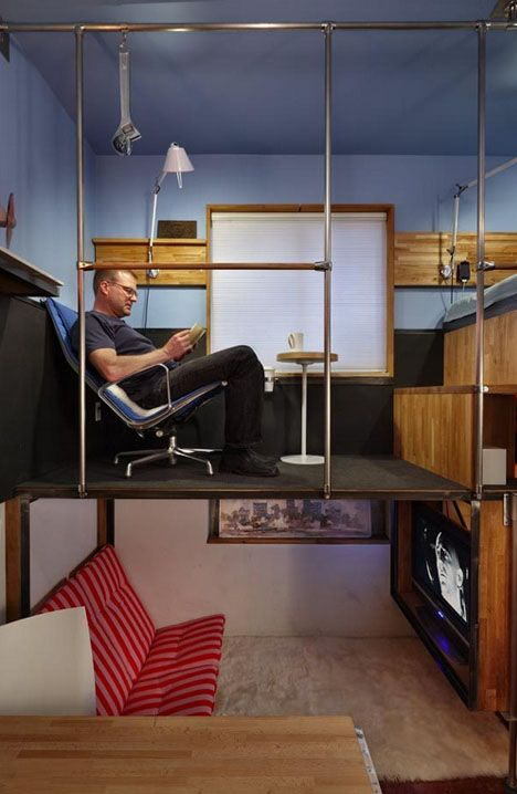 An engineer that designs airplane interiors for a living makes the most of his 180 sq ft apartment