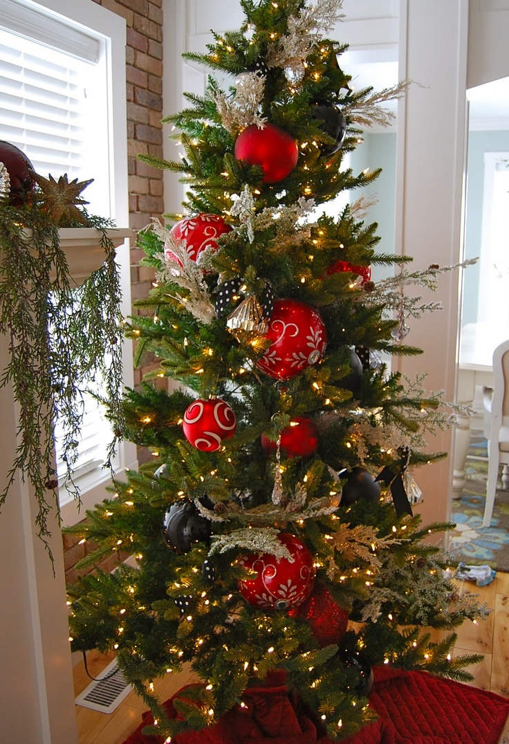 Elegant armed and Gold Gala Christmas Ornaments decorate this tree!!! Bebe'!