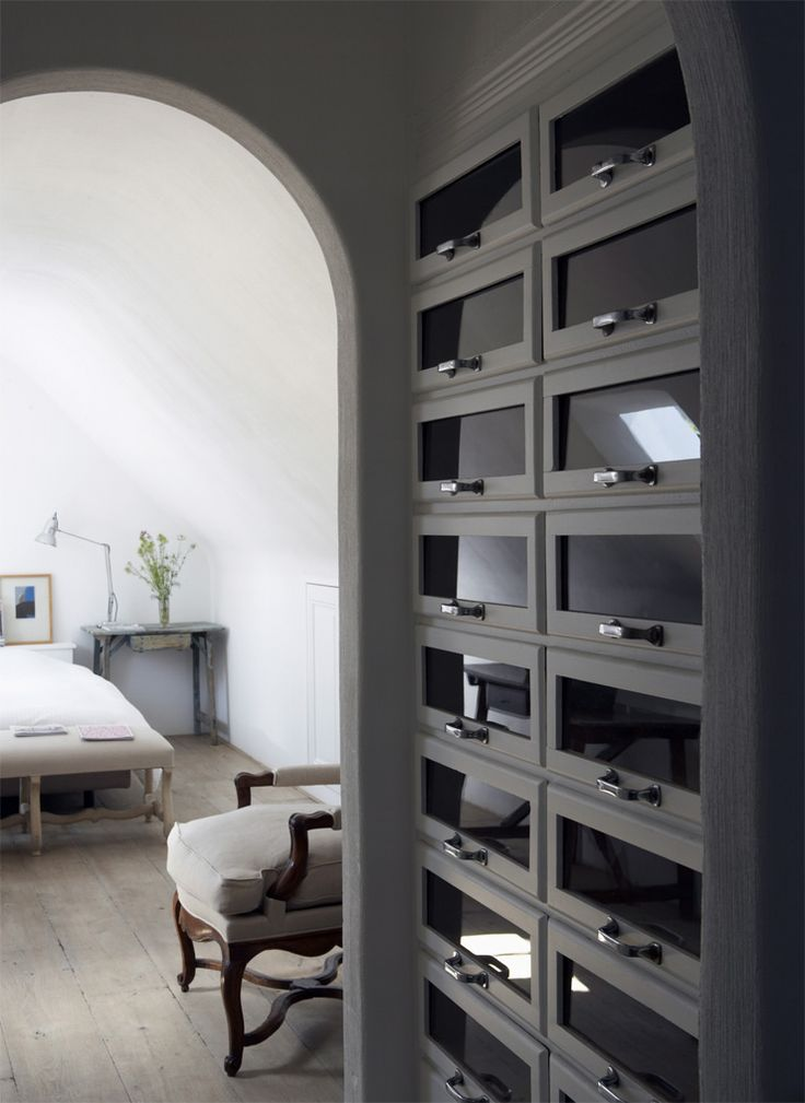 A reclaimed shop fitting is the centrepiece of this smart dressing room. Image from www.interiorarchive.com
