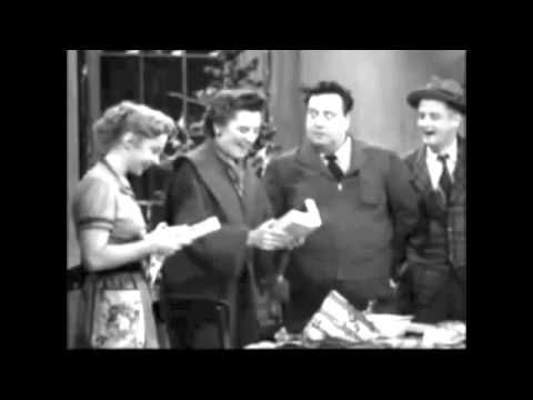 Alice & Ralph and Trixie & Norton celebrate Christmas on  'The Honeymooners' television show, 1955. --- (Xmas, yesteryear, retro, olden days)