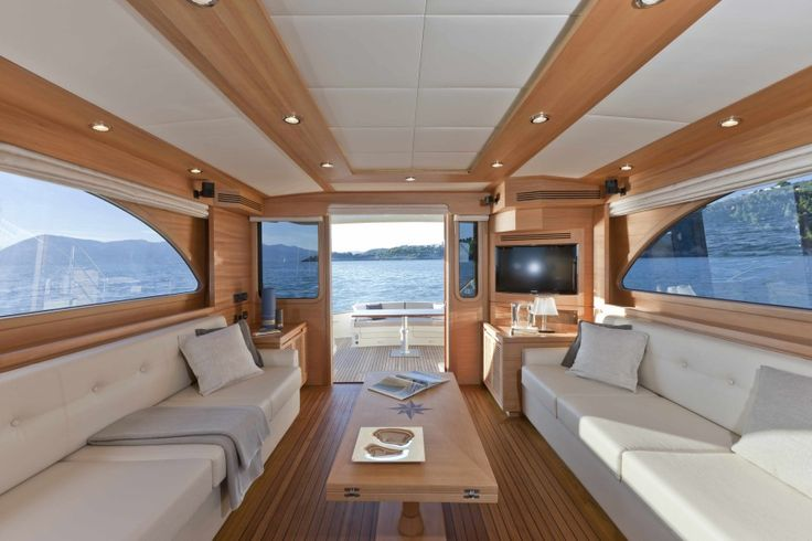 Interior Inspiring Yacht Design With Symmetrical Long Sofa Wooden Table And Floor Large Television Lamp