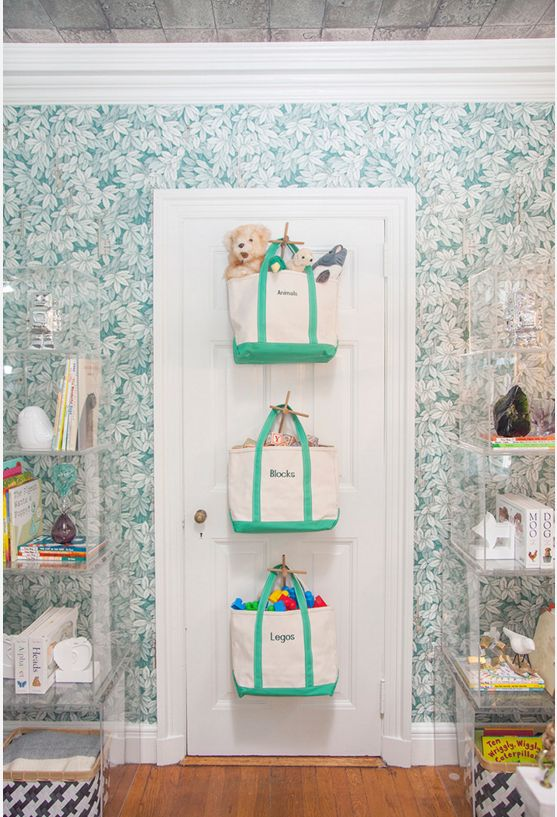 The back of a door is underused real estate. In a child's bedroom, toys can be tucked away in bags or baskets, ready to be unhooked at playtime. It's also a good place to keep a ready-packed child's travel bag to grab and go when you're in a hurry. It's a nifty idea for craft supplies, and in the bathroom, a spacious bag or basket can hold towels, cleaning gear and larger bath items.   http://www.houzz.com/photos/6096006/Show-House-Nursery-eclectic-kids-other-metro