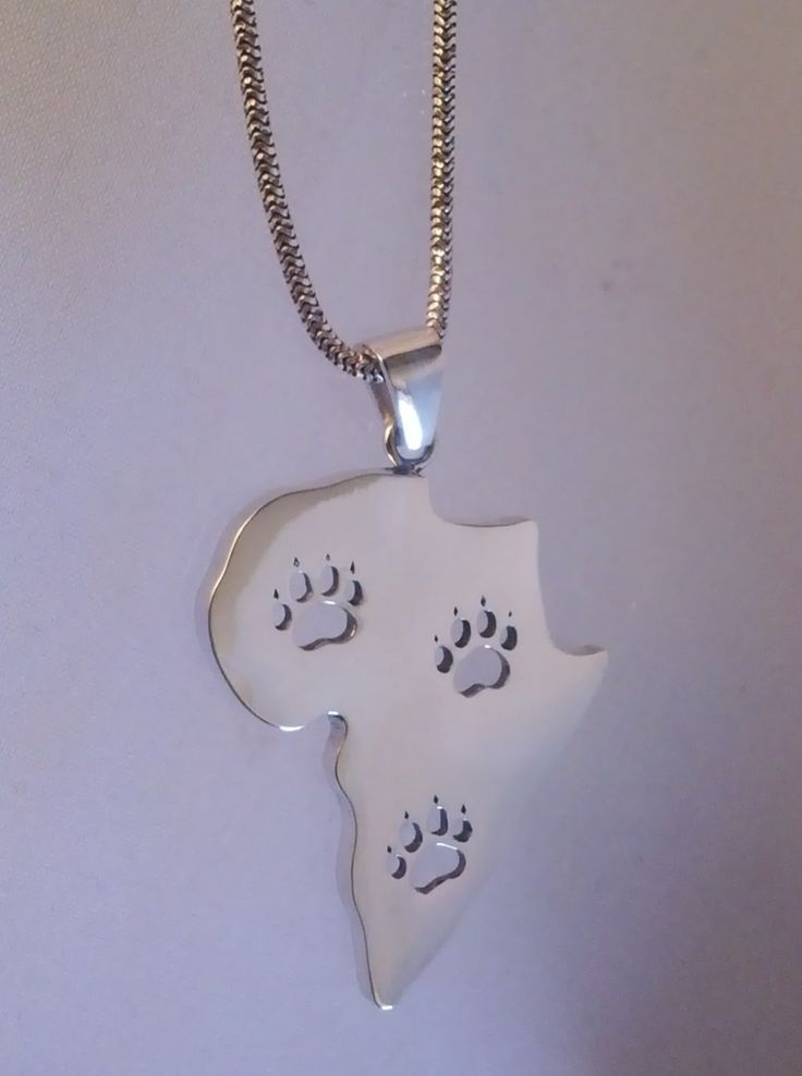 Sterling silver African map pendant with lion paw prints