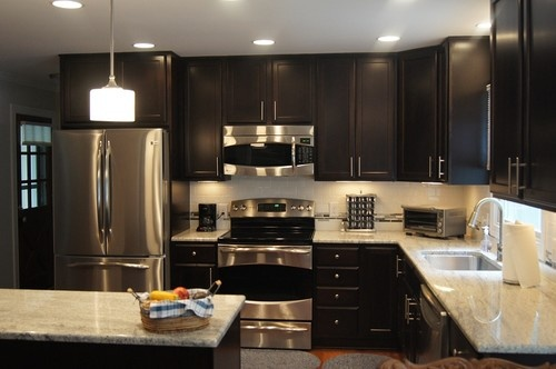 Dark Cabinets - light granite- stainless steal appliances