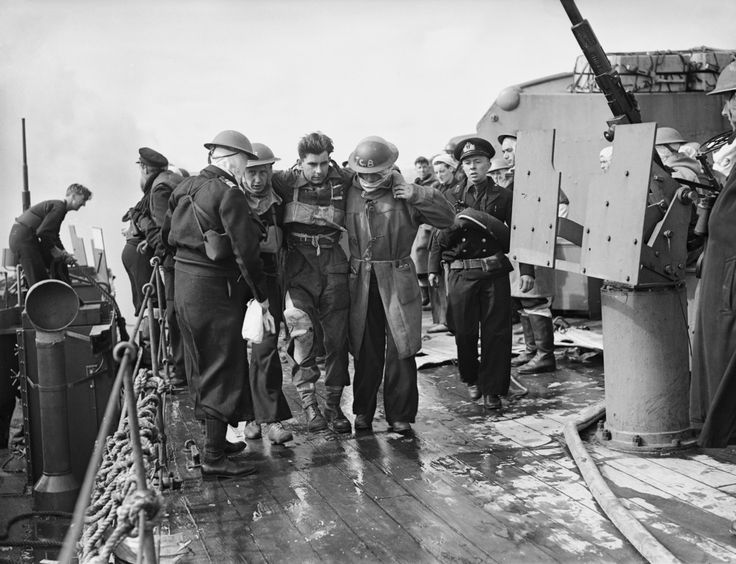 Operation Overlord (The Normandy Landings): D-Day 6 June 1944, Beach casualties being helped to the sick-bay on board HMS FROBISHER. The cruiser had helped bombard the enemy coastal positions during the week before D-Day. (Photo by Lt. E E Allen/ IWM via Getty Images)
