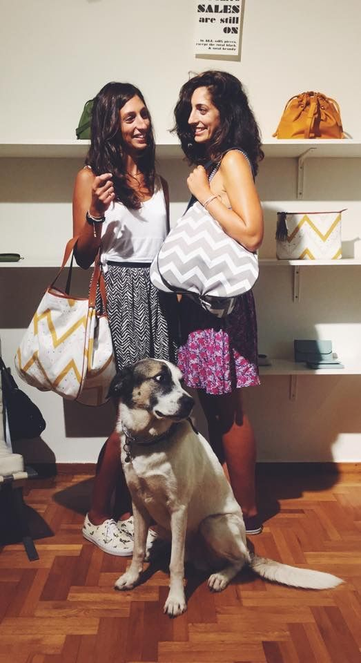 The Stai sisters holding the just-in Kalla bag from our post-vacation-never-ending-summer collection!
