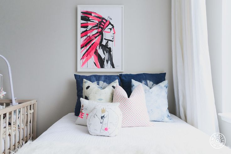 "Dannijo's Cofounder Gets Her Dream Nursery - Just a few pops of pink play into the traditional girl's room color scheme but the neon update keeps it from feeling too feminine. Indigo dyed pillows keep the colorways balanced and we love that painting by <a href=""http://jennasnyderphillips.com/"" target=""_blank"">Jenna Snyder Phillips</a>! - @Homepolish New York City"