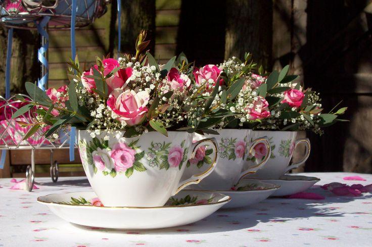 Pink vintage teacups wedding flowers.