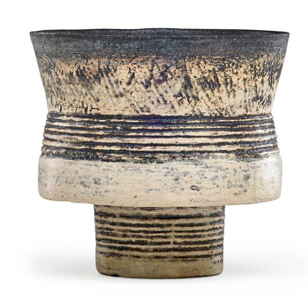 HANS COPER (1920 - 1981) Footed stoneware cup, manganese glaze and porcelain slip, England, 1950sArtist's chopmark