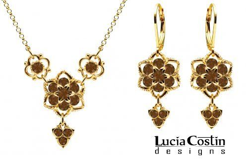 14K Yellow Gold over .925 Sterling Silver Necklace and Earrings Set Designed by Lucia Costin with Star Shaped Middle Flowers and Lovely Charms, Crafted with Twisted Lines and Brown Swarovski Crystals Lucia Costin. $125.00. Amazingly studded with brown Swarovski crystals. Floral jewelry set by Lucia Costin. Splendid combination of dangle elements. Mesmerizing enough to wear on special occasions, but durable enough to be worn daily. Unique jewelry handmade in USA